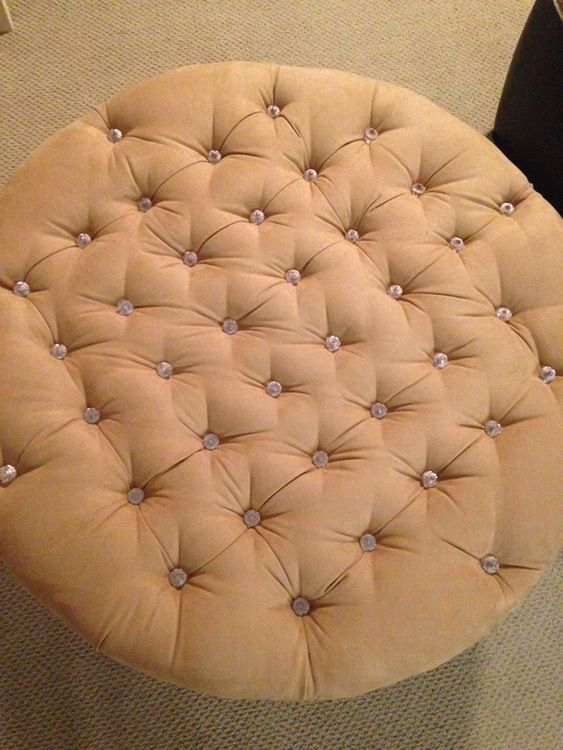 One of a kind round tufted ottoman —