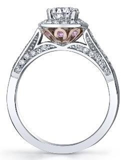 Maple Leaf Diamonds: Pink Passion Collection ~  White and rose 18 /14 Karat Canadian Certified Gold diamond ring. Set with 0.70ct round brilliant cut Canadian centre diamond surrounded by pink sapphires and round brilliant cut diamonds.#MichaelAnthonyJewellers