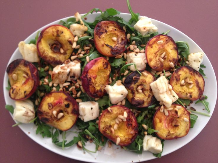 Grilled peaches, haloumi, rocket and pine nuts salad. Recipe by Scandi Foodie