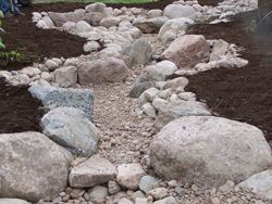 Gravel in an ecosystem pond - Aquascape