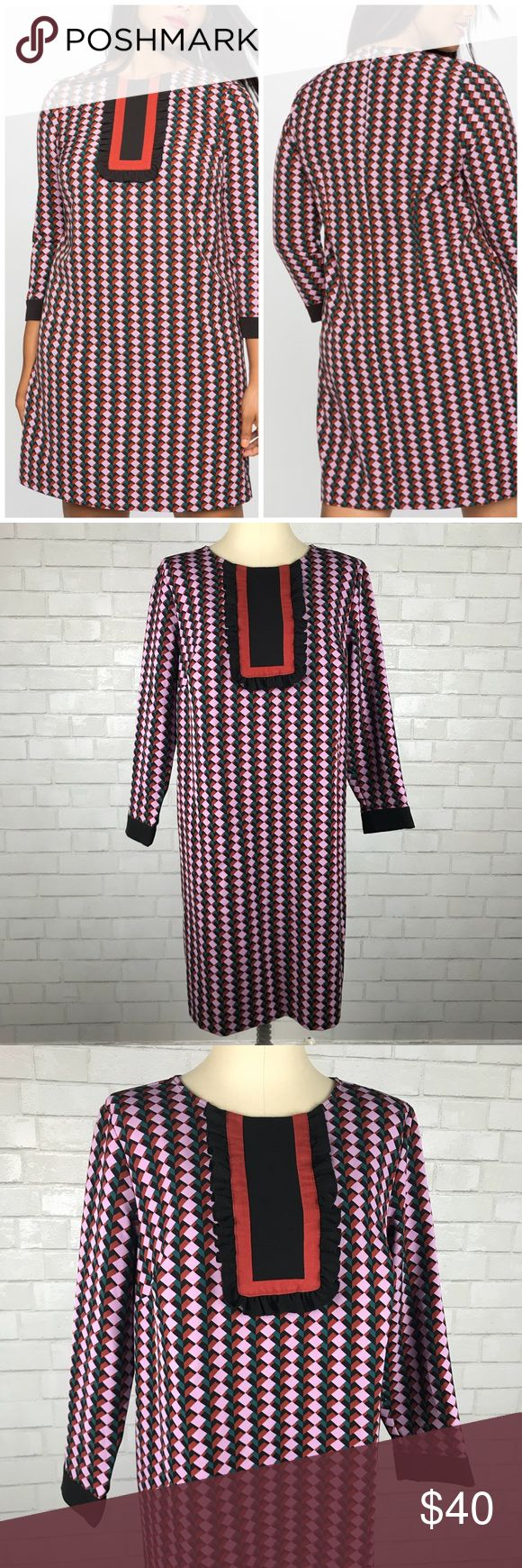 """Eloquii Printed Bib Long Sleeve Dress Excellent condition Eloquii Printed Bib Long Sleeve Dress. Size 16. Has a back zipper and ruffle trimmed bib. Thick poly/spandex skims over your curves while holding it's shape. Bust 48""""-52"""", Waist 47""""-50"""", hips 52""""-56"""", length 39"""", sleeve length 22.5"""". Mauve, green, brown and black. No trades, offers welcome. Eloquii Dresses"""