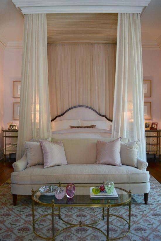 This wisp of a shell pink bedroom with those gentle canopy drapes is 99% dream and 201% restraint to keep it on the approachable side of feminine Regency design.