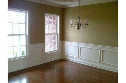 Formal dining room tanyellow walls white moulding trim filled shadow boxes wood floors