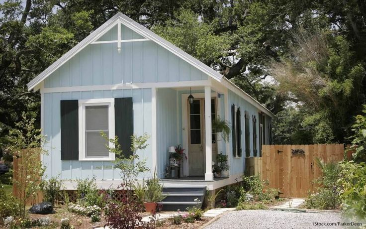 """It's no secret that tiny houses are growing in popularity across the U.S. Not only can owners of tiny homes simplify their lives by reducing possessions and space, but they also tend to pay less for mortgages, utilities, and other costs. Still, zoning laws can make it hard for average Americans to find sites for their pint-sized properties. These guidelines affect the dimensional requirements for various types of buildings. """"I think that originally those laws were there to protect peop.."""