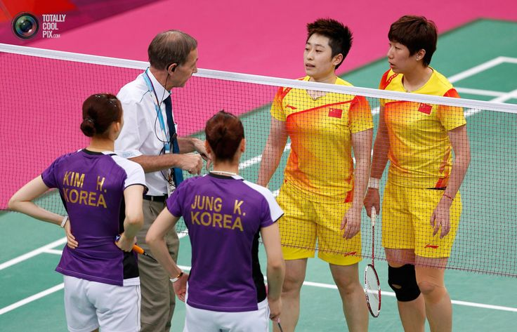 Tournament referee Torsten Berg speaks to players from China and South Korea during their women's doubles badminton match during the London 2012 Olympic Games at the Wembley Arena. BAZUKI MUHAMMAD/REUTERS