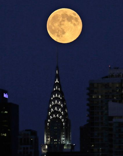 Supermoon: The August fullmoon is  when the moon is closest to the erath on its elliptical path and appears about 14 percent wider and 30 percent brighter than at its farthest. The moon will be at a distance of 356,896 km from Earth, the closest in this calendar year.  Over Chrysler Bldg., New York