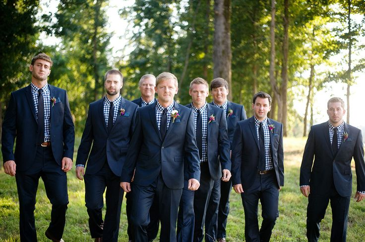Groom And Groomsmen In Classic Navy Suits With Check