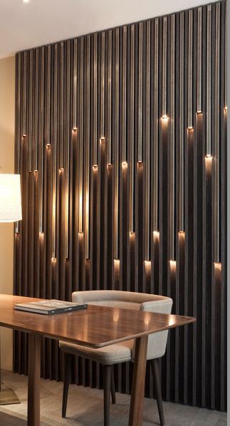 Modern office with creative wall lighting. Light rods on the wall.