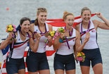 Adrienne Martelli, Megan Kalmoe, Kara Kohler and Natalie Dell of the United States celebrate on the podium after winning bronze in the Women's Quadruple Sculls on Day 5 of the London 2012 Olympic Games at Eton Dorney in Windsor, England. — Ha