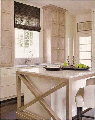 Cool Cabinets. I like it when cabinets go all the way up to the ceiling in kitchens. Also, overall nice clean natural look.