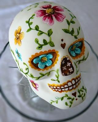 mango buttercream sugar skull cake i love it for november birthdays or halloween.
