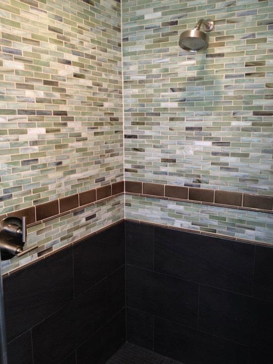 A spectacular shower using 1x4 recycled glass tiles and - Recycled glass tiles bathroom ...