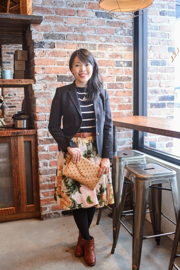 black blazer, floral skirt, sailor stripes, and touches of cognac leather.