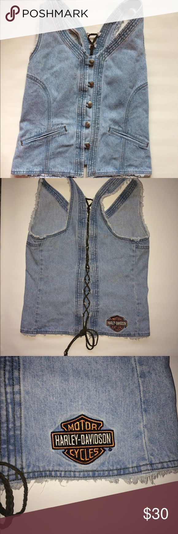 Harley Davidson Denim Vest Motorcycle Biker Light wash. Button down. Front pockets. Olive color braided leather tie up on back (can be adjusted to fit better) Distressed Hem all around  Material: 100% Cotton Condition: Good, minor discoloration on top front chest. Size Tag Reads:  XL Measurements:  Chest: 34 Inches (17 inches across form armpit to armpit X 2) Waist: 34 Inches (17 inches across X 2) Length: 23 Inches Arm hole opening: 23 Inches around:  Thank you so much for stopping by.I…