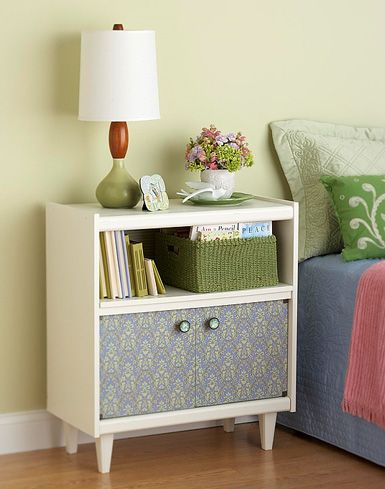 To turn an old castoff into a charming bedside table, start by removing the casters and replacing them with new wooden furniture feet. Prime and paint the cart. Remove the doors and decoupage the fronts with decorative paper. Cut a new back for the cart from í-inch plywood and decoupage it with coordinating paper. Add new knobs to the doors and reinstall.