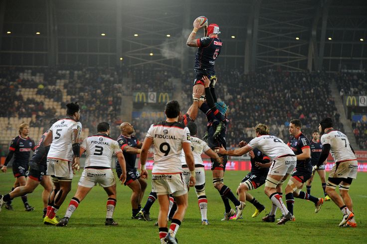Grenoble's English lock Aly Muldowney grabs the ball in a line out during the French Top 14 rugby union match between Grenoble (FCG) and Stade Toulousain (ST) on december 22, 2016 at the Stade des Alpes in Grenoble, southeastern France. JEAN-PIERRE...