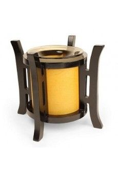 """This Asian lantern style oil warmer measures 6.5"""" tall and 6.25"""" diameter. Orange cylinder with bronze tinted dish for the oil. Uses one 35 watt halogen bulb (included). You can use either scented oils or tarts in this oil warmer. The 36"""" power cord has a built in dial that allows you to adjust the heat and light. Turn it up to use as a lamp, turn it down for use as a night light. Attractive design compliments any style or decor."""