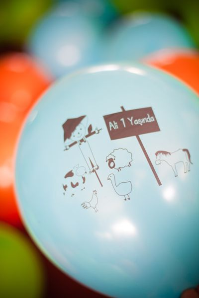 Ali welcomes all with blue baloons