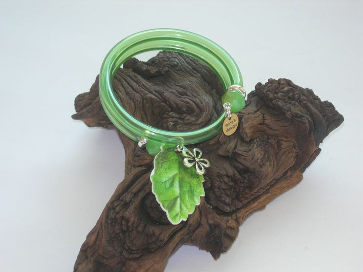 industrial green gum tube, green crystals, silverplated flower, blooming leaf paper https://www.facebook.com/FinnysDesign?ref_type=bookmark