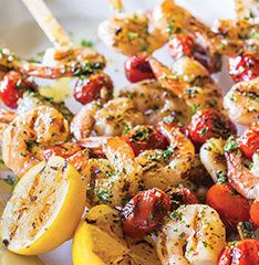 Grilled Jumbo Shrimp with Tomatoes - Serve off the skewer on fresh lettuce and a drizzle of vinaigrette for an elegant, light luncheon.