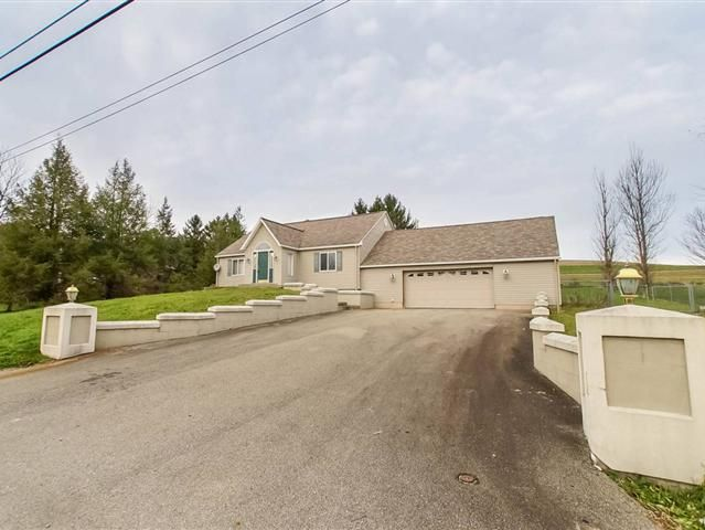 This appealing ranch is big on charm and livability Tucked on over 34 acre the dramatic cathedraled entry opens to a lovely living room with fireplace kitchen with island dishwasher range and microwave 2 bedrooms with potential for a 3rd bedroom in the upper level Attached garage deck and a detached garage would make a perfect workshop pub hub or home office Full basement and fenced backyard too Central access to Uniontown and Brownsville
