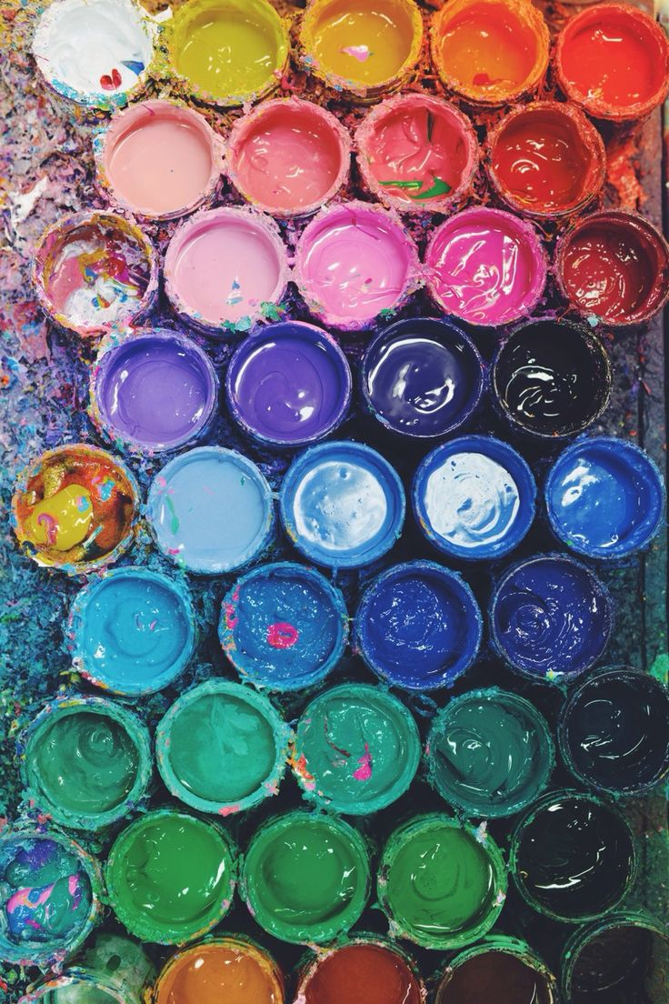 Paint buckets in different colors aligned together for Artist canvas paint color