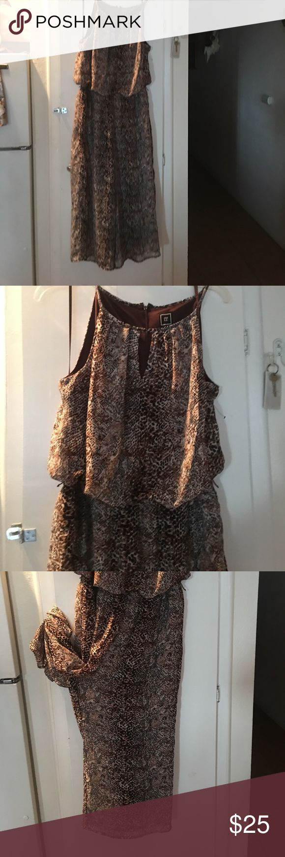 Wide leg animal print jumpsuit . Animal print gathered waist spaghetti strap , boat neck style w keyhole neck. Comfortable fit light summer material . Team with black pumps and blazer for work . Dress Barn Pants Wide Leg