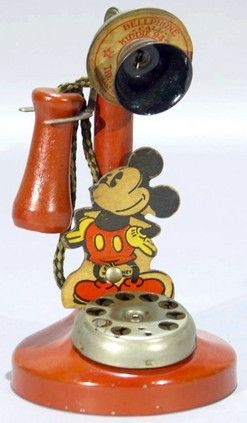 toys, New Jersey, A Walt Disney Mickey Mouse Toy Telephone made by the NN Hill Brass Company, circa 1930s. Tin and cardboard.