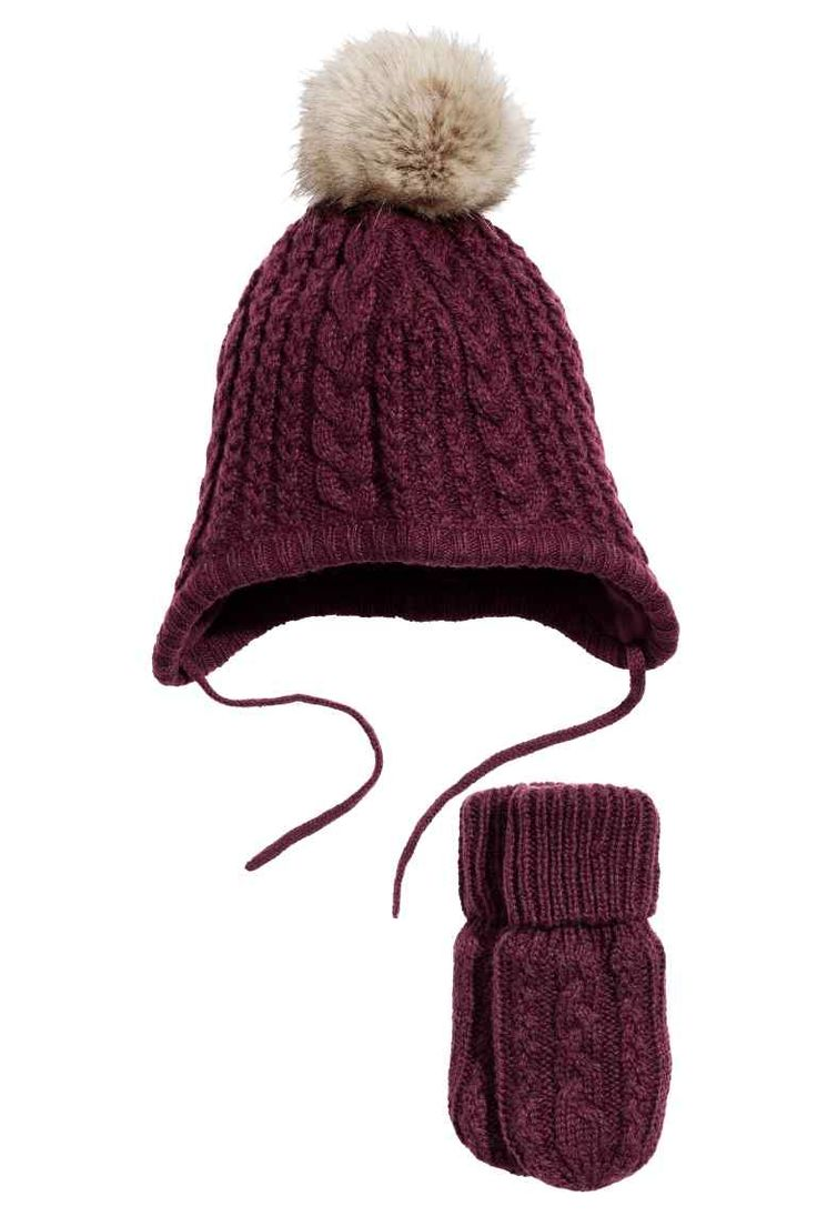 Hat and mittens: Cable-knit hat with matching mittens in soft yarn containing…