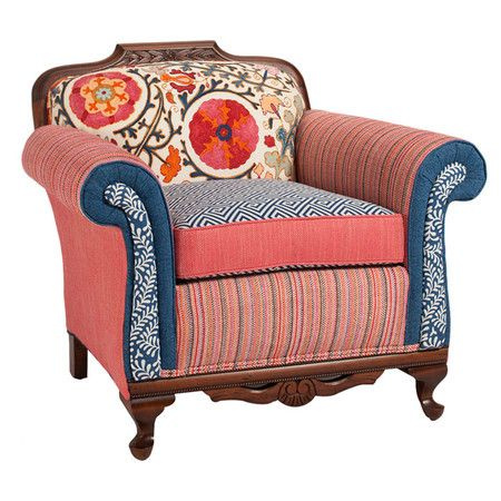 featuring a carved hardwood frame and multiprint upholstery this eyecatching arm