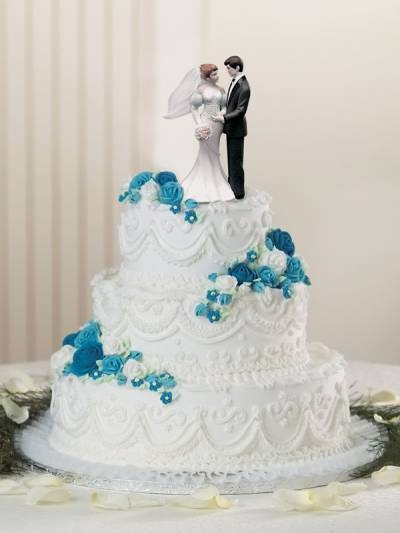 change the blue to red, put a different topper on it, and that's our cake! Beautiful designs.
