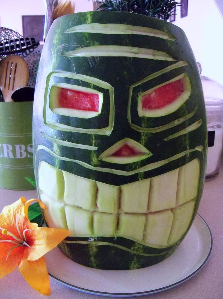 carved  watermelon tiki! thanks to Wolfgang Puck I have the utensils to make this happen!!