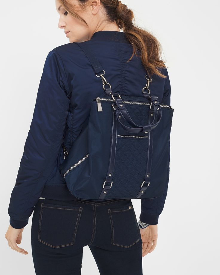 """Laid-back yet luxe, our quilted backpack redefines big-city accessorizing. Multiple pockets will organize essentials, like credit cards, phone and lipstick, while refined convertible straps complete this design with a feminine edge.  Quilted backpack in officer blue Nylon with Nappa PU trim and center front quilted detail 2 inner pockets; 1 front outside pocket 2 removable and adjustable backpack straps Silver hardware; zipper closure; feet on bottom Approx. 14 1/2"""" x 13"""" x 5 1/2""""…"""