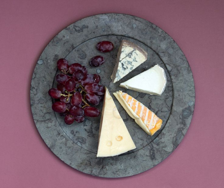 Cheese and grapes on limestone plate from Stenhuggardottern
