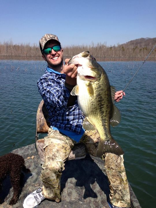 Luke bryan sporting his costas and a huge bass for Lake bryan fishing