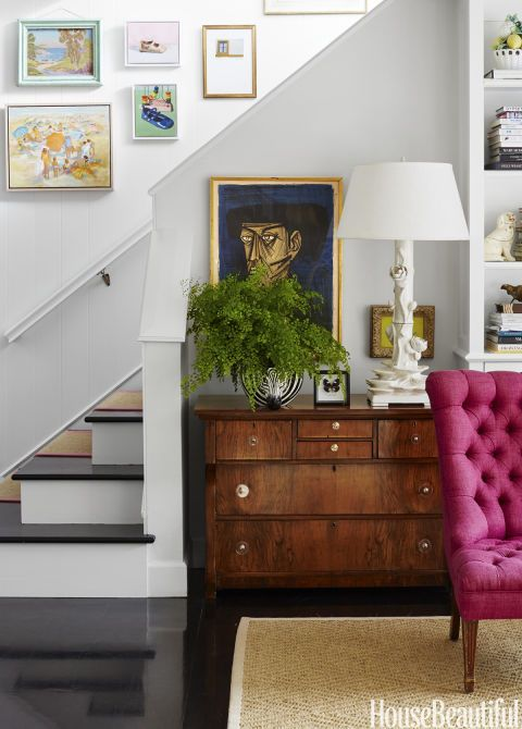 """""""I don't usually like brown furniture, but this vintage chest, updated with Lucite knobs, was too good to resist,"""" Ewart says."""