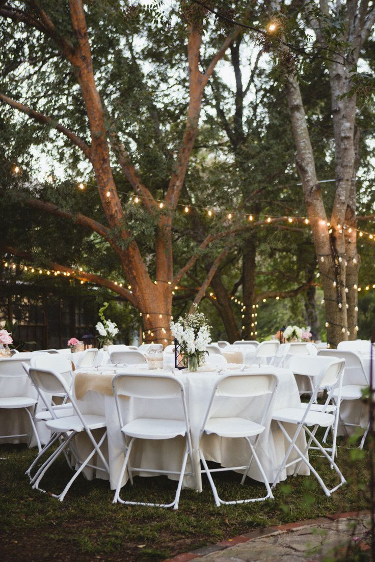 beautiful outdoor wedding amongst the trees with lights!