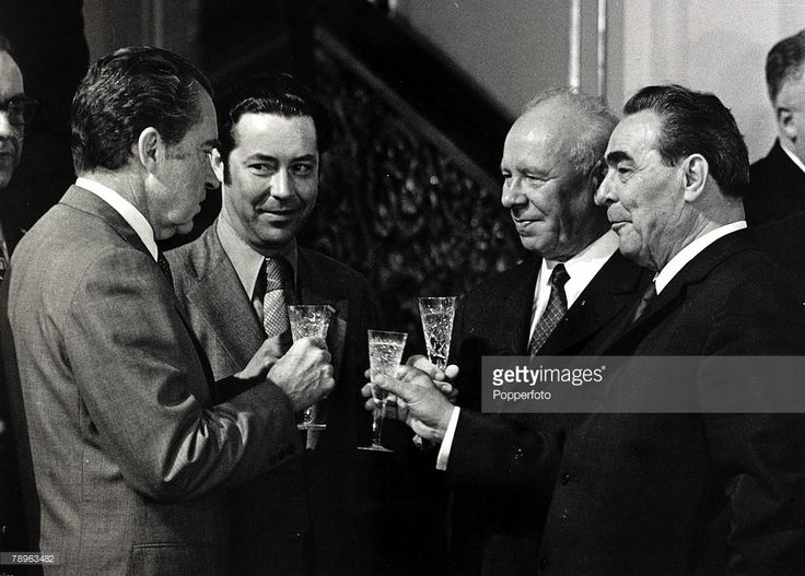 26th May 1972, US President Richard Nixon (left) with Nikolai Podgorny (second right) and Russian President Leonid Brezhnev (right) as they toast the signing of a US-Russia space flight agreement in Moscow