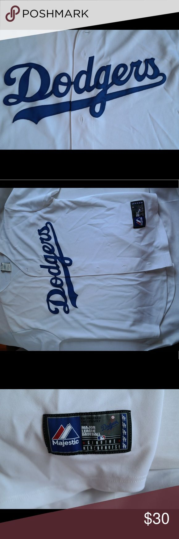 Dodgers' jersey - Men's Large Serious Dodger fans will love this jersey! Purchased at Dodger Stadium, fabric is thick and will keep you warm in the playoffs! Shirts Tees - Short Sleeve