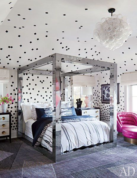 The daughter's bedroom, with its Paul Evans four-poster, is sheathed in a custom-made wall covering by Porter Teleo; the vintage ceiling fixture and parchment-front dressers are from JF Chen, and the customized carpet is by the Rug Company.