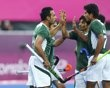 Pakistan's players celebrate their goal against Argentina during their men's Group A hockey match at the London 2012 Olympic Games at the Riverbank Arena on the Olympic Park August 1, 2012. REUTERS/Dominic Ebenbichler (BRITAIN - Tags: SPORT FIELD HOCKEY OLYMPICS) - http://www.PaulFDavis.com/success-speaker (info@PaulFDavis.com)