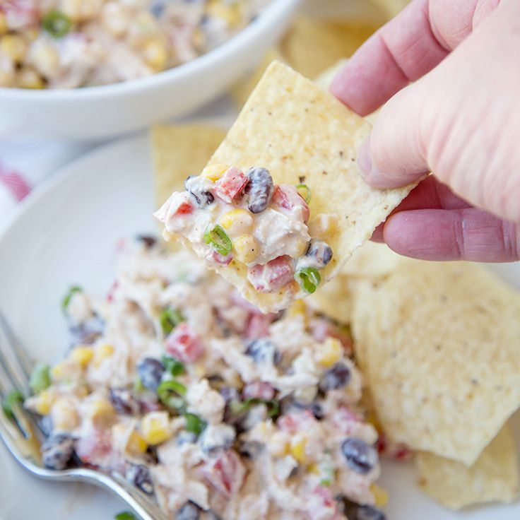 Skiny Southwest Chicken Salad - Made with tons of healthy veggies and a creamy and flavorful Greek Yogurt dressing. Perfect for a light lunch or snack.