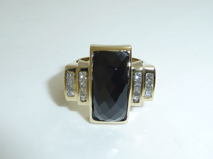 Checkered Onyx and diamond yellow gold dress ring. Link in bio.