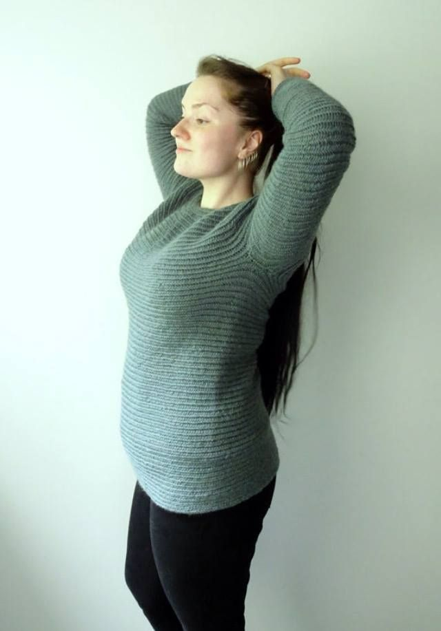 Needlebound / nalbound sweater made with 12 balls of thin teal pure wool using the Mammen stitch, by Perrine Désert. Bottom-up approach. Took her 41 hours to make, Posted [in English] 2016-06-19 in the Nålbinding : stitch-along sweater group @ Facebook. Please see link for album for photo of sweater when laid out flat [as well as photos of her other sweaters]!