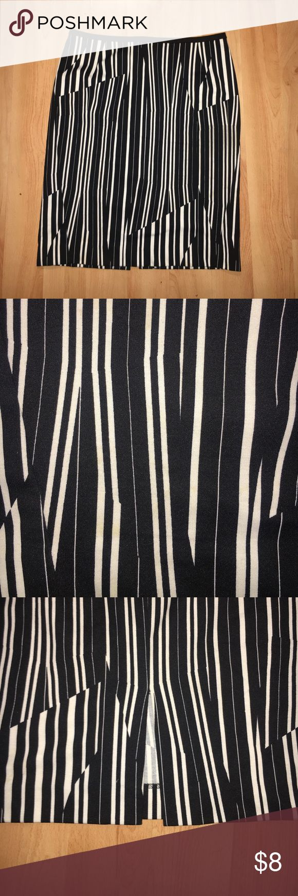 "H&M Striped Pencil Skirt Black and white striped pencil skirt. Zipper and clasp closure at the back of skirt. Length of skirt is about 21"" and the waist is about 31.5"". Worn once and in great condition. H&M Skirts Pencil"