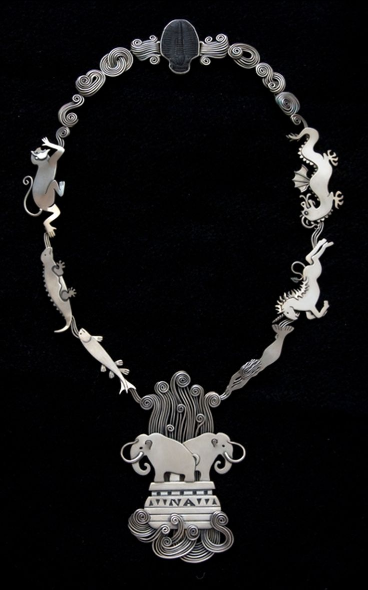 "Necklace | Ahlene Walsh. ""Intelligent Design"". Sterling silver and trilobite."