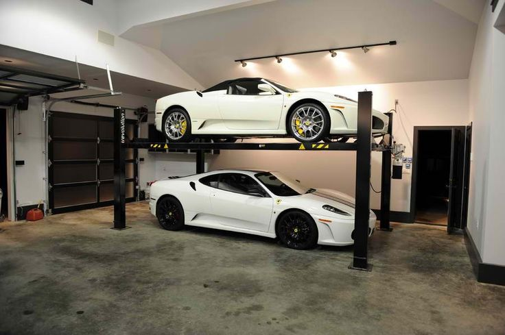 Car lift storage rack dream garage pinterest cars for Over car garage storage