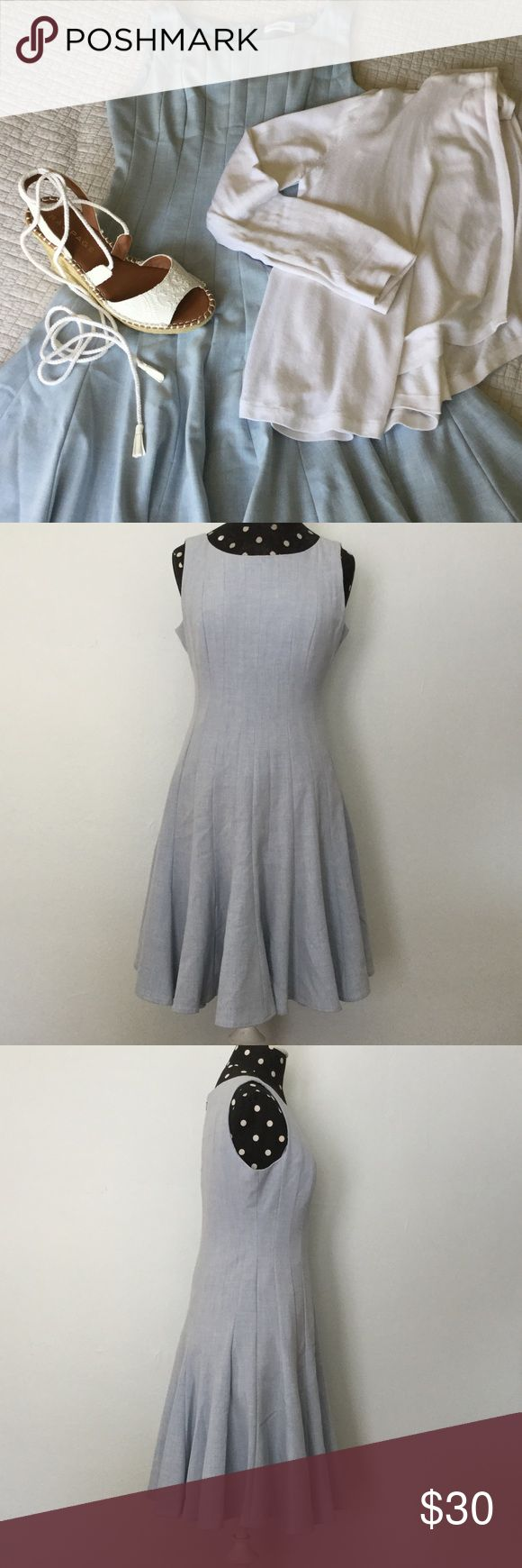 """Calvin Klein Dress 👗This Tank style dress is such a pretty shade of light blue. It has a shallow scoop neckline; sleeveless; zipper at back; & fully lined. Skirt is very full at hemline so lots of """"swing"""" action. Layer a sweater over for chilly nights & add your casual espadrilles to complete the look or wear a structured jacket for office. Options! In EUC as only worn a few times. 36"""" bust; 28"""" waist; 35"""" shoulder to hem. Calvin Klein Dresses"""