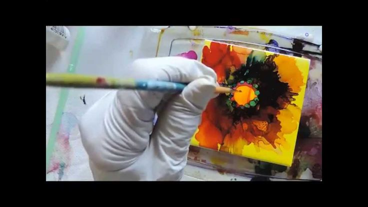 Wonderful video demonstrating alcohol inks on ceramic tile with compressed air effects.
