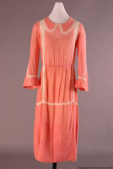 A semi-sheer cotton day dress in a shockingly bright shade of salmon.  This dress was worn by Elizabeth Parke Firestone (wife of Harvey S. Firestone, Jr.) on a summer camping trip in Canada in 1921.